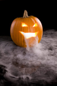 A Jack-o-Lantern with mist pouring from it's mouth